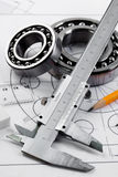 Compasses and the drawing. Royalty Free Stock Images