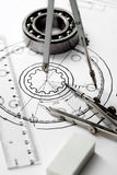 Compasses and the drawing. Stock Photo