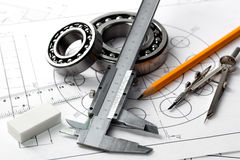 Compasses and the drawing. Stock Photography