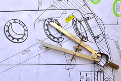 Compasses and the drawing. Compasses over a mechanical sketch Stock Photo