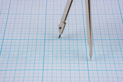 Compasses on graph paper Royalty Free Stock Images