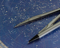 Compasses on the map Stock Photos