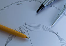 Compasses with Pen. Compasses and pen on the white paper Stock Images