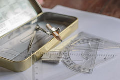 Compasses, pencil and rulers on squared paper Royalty Free Stock Photography