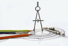 Compasses and pencils on the drawing Stock Images