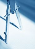 Compasses strategy. Compasses, toned in blue, short DOF