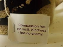 Compassion... Kindness. Compassion has no limit. Kindness has no enemy Stock Image
