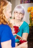 Compassionate Woman Listens to Friend royalty free stock images