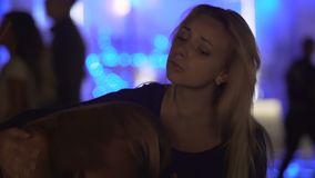 Compassionate young woman supporting upset female friend at nightclub party. Stock footage stock video