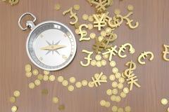 Compasso à procura do ouro Fotos de Stock Royalty Free