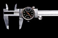 Compasso de calibre gasto no preto Foto de Stock Royalty Free