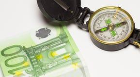 Compasso e dinheiro Fotografia de Stock