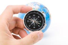Compasso e globo fotografia de stock