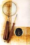 Compasso e magnifier Imagens de Stock