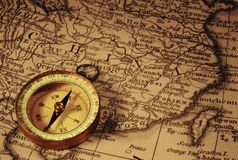 Compasso e mapa de China foto de stock
