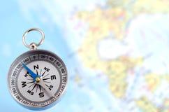 Compasso e mapa de prata Fotografia de Stock Royalty Free
