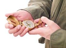 Compasso nas mãos Fotografia de Stock Royalty Free