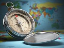 Compasso no fundo do mapa do mundo nearsighted imagens de stock royalty free