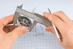 Compassos de calibre, rolamento e quadrado Imagens de Stock