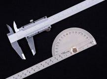 Compassos de calibre vernier e prolongador Fotografia de Stock Royalty Free