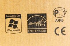 Compatibile con Windows 7, la stella di energia, il segno del CE ed il Russo Stan immagini stock libere da diritti