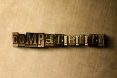 COMPATIBILITY - close-up of grungy vintage typeset word on metal backdrop. Royalty free stock illustration.  Can be used for online banner ads and direct mail Royalty Free Stock Images