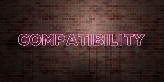 COMPATIBILITY - fluorescent Neon tube Sign on brickwork - Front view - 3D rendered royalty free stock picture. Can be used for online banner ads and direct Royalty Free Stock Photos