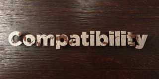 Compatibility - grungy wooden headline on Maple  - 3D rendered royalty free stock image. This image can be used for an online website banner ad or a print Stock Photos