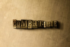 COMPATIBLE - close-up of grungy vintage typeset word on metal backdrop Royalty Free Stock Photos