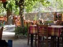 Compatible with the nature of Samothraki island old cafes Royalty Free Stock Photos