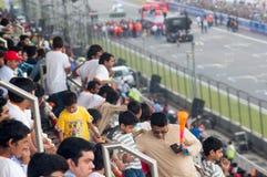 Competência de observação do caminhão da multidão indiana Imagem de Stock