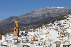 Competa white village in Andalusia, Spain. View across the rooftops of Competa white village in Andalusia, Spain showing the church tower of La Asuncion and with Stock Images