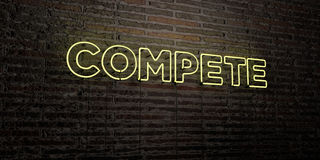 COMPETE -Realistic Neon Sign on Brick Wall background - 3D rendered royalty free stock image Royalty Free Stock Images