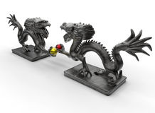 Compete for superiority concept. 3D rendered illustration for concept of competing for superiority. The composition uses two dragon metallic statues and each Royalty Free Stock Photos