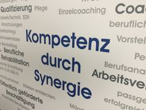 Competence through synergy. Advertisement message: Kompetenz durch Synergie German for Competence through synergy stock photo