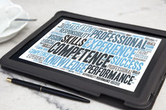 Competence. Tablet with competence word cloud stock image