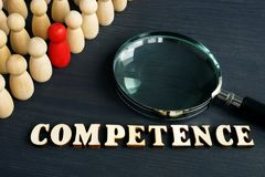 Competence from wooden letters and figurines. On a desk stock photo