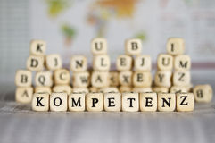 Competence. Word on newspaper background royalty free stock image
