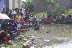 Competencia de la pesca de los pescados Imagen de archivo