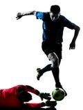 Competencia del portero del jugador de fútbol de dos hombres Fotografía de archivo
