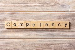 Competency word written on wood block. Competency text on table, concept royalty free stock images