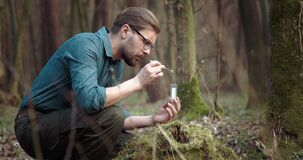 Competent biologist taking moss for test in laboratory