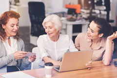 Competent business ladies briefing their boss. Collecting new information. Hardworking dedicated active colleagues sharing the updates of their project with royalty free stock photos