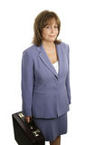 Competent Businesswoman. An attractive, competent looking business woman in a blue suit with a briefcase Stock Photo