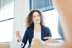 Competent businesswoman during negotiation. In start-up Stock Photos