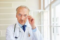 Competent chief physician. Competent self confident chief physician at hospital Royalty Free Stock Photos