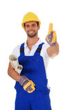 Competent construction worker showing thumbs up. Portrait of a competent construction worker showing thumsb up. All on white background Stock Photo