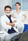 Competent dentist team with dental assistant Royalty Free Stock Photography