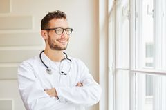 Competent doctor proud of his profession. Looking self-confident Royalty Free Stock Photography