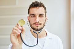 Competent doctor with stethoscope. As physician Stock Images
